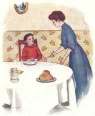 Mother serving child at the table